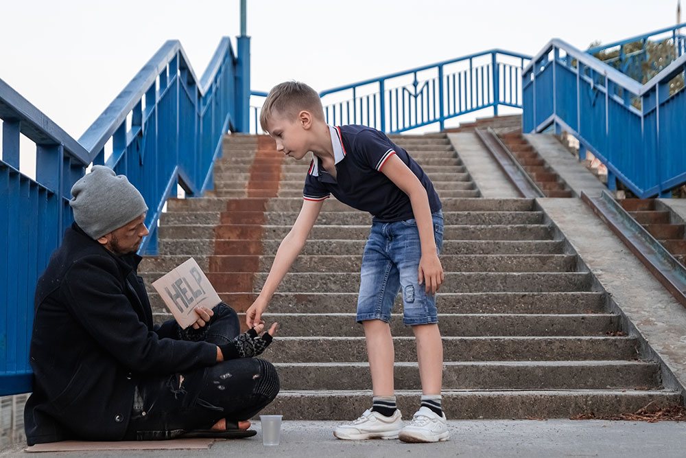 Boy helps homeless street
